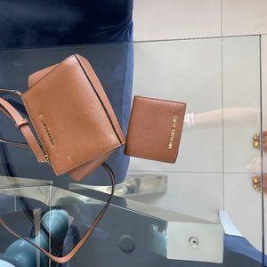 Micheal Khors tan crossbag and matching wallet